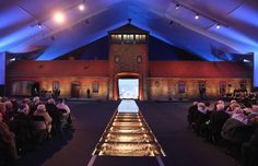The original entrance gate to the former Auschwitz-Birkenau concentration camp stands encased under a tent during ceremonies marking the 70th anniversary of the liberation of Auschwitz in Oswiecim, Poland on Jan. 27, 2015.