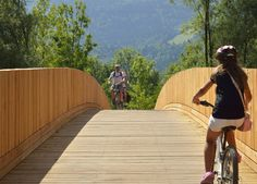 DANS Architects used timber planks and shingles to create this footbridge and cycle path.