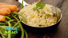 """A rice delight that is loaded with veggies and flavoured subtly with a fine choice of spices, the Vegetable Pulao is one dish that is famous all over the world. Within India too, it is so popular that there are umpteen versions, ranging from mild to spicy, and it is available in even tiny restaurants and roadside eateries! This Vegetable Pulao is a <a href=""""recipes-for-quick-recipe-325"""">Quick Recipe</a> and easy to make, but very tasty, with the added flavours of ginger, green chillies a..."""