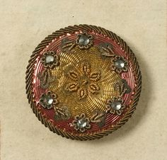 Button (image 8) | French | 1790 | no medium available | Metropolitan Museum of Art | Accession Number: C.I.39.78.1 – .104