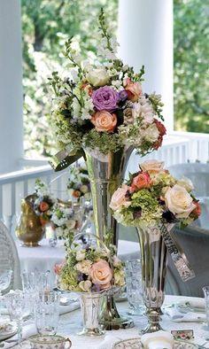 Flowers in silver vases.