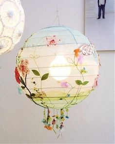 Sweet hanging paper lantern with pretty colors and flowers. I love lighting.