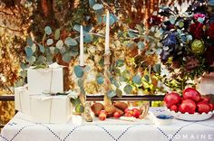 Dianna Agron's buffet table with tall taper candles, eucalyptus and pomegranate displays.