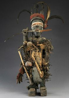 Africa | Power figure from the Yombe people of Mayombe, Bas-Congo, DR Congo | Wood, feather, pigment, vegetal fibre, nut, metals | ca. 1919