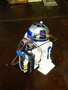 R2 Arduino!  No remote? No problem. Motor shield and UNO controls this little droid.  Ultra sonic for avoidance control.
