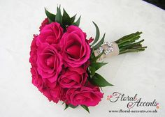 pink wedding bouquets pictures | vintage brooch gives this hand-tied bridal bouquet of raspberry-pink ...