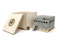 This 72pc cinder block pallet comes with it's own shipping crate! The heavy duty real wood crate makes it the perfect gift. It comes with 72 of our flat-faced cinder blocks on top of a real wood pine pallet. The pine pallet is constructed with real miniature nails. A perfect gift for architects, makers & many more! Once wrapped in shipping wrap - it is placed into our branded wooden shipping crate for safe keeping.