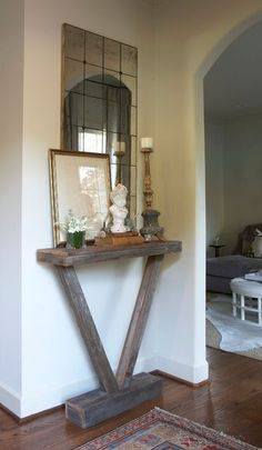 small-entryway table... an easy DIY. Interesting idea. Maybe time to change up the foyer cabinets.