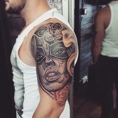 Sugar skull tattoo on man's shoulder presenting skull of woman - very realistic and beautiful tattoo