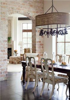 whitewashed brick wall and interesting oval burlap chandelier shade