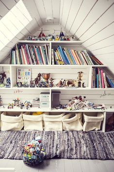 We love this fun kids attic nook complete with plenty of storage for toys and books.