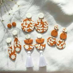 icu ~ Pin on jewelry ~ Orange floral slab all cut up 🧡🍂 These cuties and many more will be at my stall on Thursday at Victoria University so make sure you stop by! Polymer Clay Projects, Polymer Clay Creations, Ceramic Jewelry, Polymer Clay Jewelry, Cold Porcelain Jewelry, Fimo Clay, Clay Beads, Diy Clay Earrings, Paper Earrings