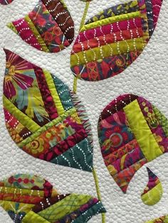 useful way to use up scraps of material -sew scraps together to make fabric, then cut out applique pieces.