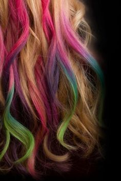 Pink, blue, green highlights on blonde hair