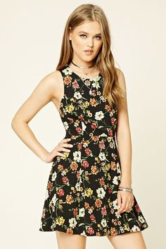 A woven sleeveless dress featuring a floral print, round neckline, crisscross straps in back, self-tying sash laces, a horizontal back cutout, and a concealed back zipper.