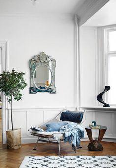Retro armchair teamed with a decorative mirror/ Pernille Teisbaek