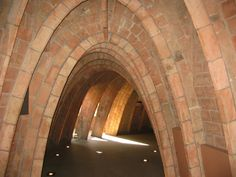 Gaudi's parabolic arches, constructed of brick and mortar, support the roof of Casa Mila Exterior Design, Interior And Exterior, Masonry Construction, Antoni Gaudi, Barcelona Travel, Brick And Mortar, Lost In Space, Concrete, Stairs