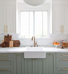 How to style your kitchen with two tone kitchen cabinets! Browse through 13 different two tone kitchen cabinets for the ultimate kitchen cabinet inspiration. For more paint and kitchen decorating ideas go to Domino. Two Tone Kitchen Cabinets, Green Cabinets, Painting Kitchen Cabinets, White Cabinets, Kitchen Paint, Kitchen Backsplash, Upper Cabinets, Kitchen Cabinetry, Farmhouse Cabinets