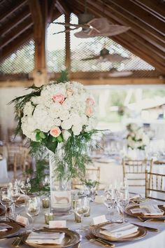 Wedding reception centerpiece idea; Featured Photographer: Shaun Menary Photography