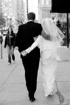 bride and groom walking in boston