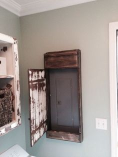 My hubby made this sweet distressed door cover for the electrical panel in our laundry room. - My Interior Design Ideas Primitive Laundry Rooms, Unfinished Laundry Room, Pallet Laundry Room Ideas, Farmhouse Laundry Room, Basement Remodeling, Basement Ideas, Remodeling Ideas, Basement Designs, Dark Basement