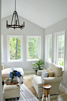 Small sunroom decorating ideas on a budget. Just by adding new paint, new lighting and moving furniture around we have a comfortable new living space. Sunroom Decorating, Sunroom Ideas, Decorating Ideas, Indoor Window Boxes, Small Sunroom, Moving Furniture, Outdoor Ceiling Fans, Furniture Arrangement, Home Renovation