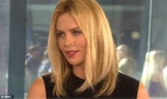 looooooove Charlize Theron's hair lately. Long bob, not much layering in the front. love it.