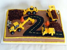 Construction site cake with fondant rocks and cones and crumbled cake dirt.