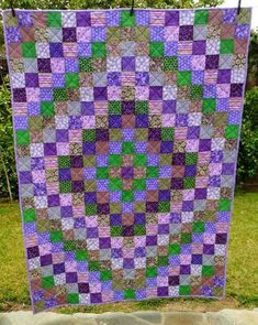 "This ""Trip Around the World"" quilt is beautiful in purples and greens."