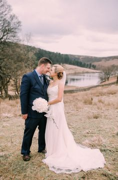 The sweetest rural wedding photo of Lizzie wearing the 'Leia' gown with new hubby