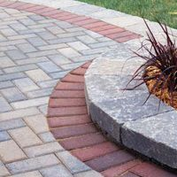 pavers with bordered flower bed