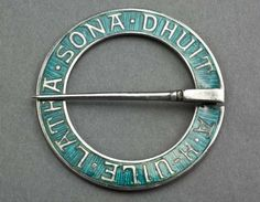 """A rare silver and green enamel annular brooch designed by Alexander Ritchie, the famous Iona silversmith. The brooch has a Gaelic inscription """"A h-uile latha sona dhuit"""", translated """"May all your days be happy""""."""