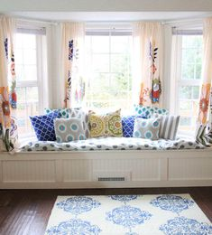 Add extra storage and seating to your favorite room by building a simple window seat. (From @Alisa Burke)