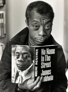 """Author James Baldwin holding a copy of """"No Name in the Street"""" by James Baldwin. Lover Of the People. James Baldwin, Gil Scott Heron, Black Authors, Writers And Poets, Cinema, No Name, Powerful Quotes, African American History, Performing Arts"""