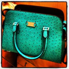 Michael Kors Gia ostrich-embossed satchel in turquoise.