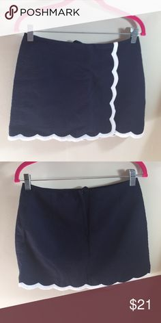 Lilly Pulitzer Skort - NWOT Navy and white Lilly Pulitzer Skirt. White scalloping on the bottom. Textured material. Shorts underneath are navy. Skort has never been worn. Lilly Pulitzer Shorts Skorts