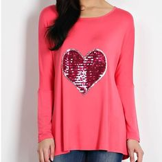 Pink Sequined Heart Top This top features long sleeves and a sequined heart detail on the chest. This top will look super cute to wear on Valentines Day. Sizes: S M L. Comment below with size & I will create a listing for you to purchase. Tops Tees - Long Sleeve