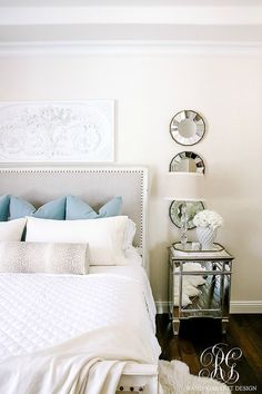 White master bedroom with blue velvet pillows and antelope bolster pillow. Headboard with nailhead trim, mirrored side table. Soothing Summer Home Tour 2017 - Neutral Transitional Home Decor