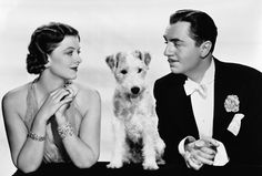 Myrna Loy and William Powell as Nick and Nora Charles, along with Asta, from the Thin Man movies of the 1930s and '40s.