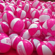 How could you not have fun in the pool with this many PINK beach balls?