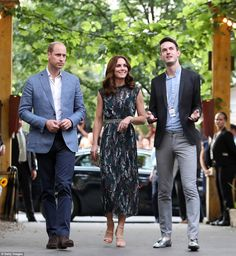 Charming the locals: The Berliner Zeitung said pictures of the Duchess cuddling children d...