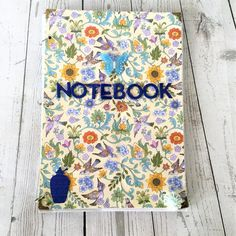 Gorgeous lined notebook with beautiful birds and flowers cover.