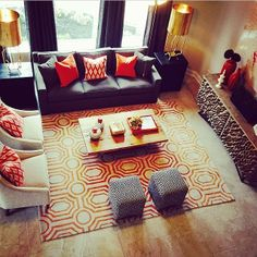 A great room with orange accents gets a geometric punch with the Angelo Surmelis designed Hudson Park Collection rug from Surya. (HDP-2009) @Angelo Surmelis
