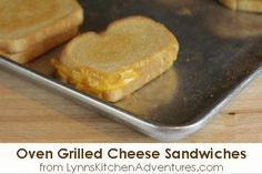 Oven Grilled Cheese Sandwiches, bake at 425.  One side for 6-8 minutes, other side for 3-4 minutes more.  Great idea!