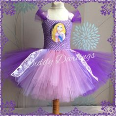 Rapunzel Tutu Dress Beautiful & lovingly handmade.  All characters and colours available Price varies on size, starting from £25.  Please message us for more info.  Find us on Facebook www.facebook.com/DiddyDarlings1 or our website www.diddydarlings.co.uk