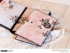 Hello! Evgenia is here and today I want to share with you my new romantic mini album from P.S. I love You collection. This truly is a stunning collection! Colors and backgrounds and texture are perfect! Kaisercraft products: PK548 Paper Pack | PP1010 paper Pad | CS 277 Clear Stamps | SS327 Sticker Sheet | CT870 Collectables | FL590 Flourish Pack Love | EM926 Lace Pack White | IP719 Ink Pad Black | IP725 Ink Pad Petal Pink | KM111 Kaiser Mist White | CS257  Stamps Background Script | RS409…