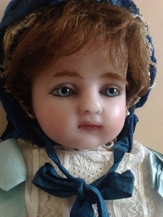 A beautiful 28 inch English poured wax doll made by a mannequin maker for his daughter in 1889.