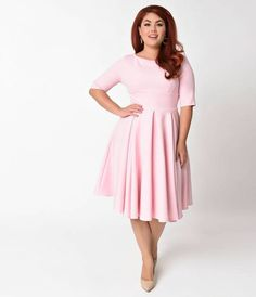 Send hearts racing, gals! The beautiful Hepburn Dress from The Pretty Dress Company is a classic Pin-up 1950s inspired piece, created using a stunning luxe crepe blend. Featuring a graceful vintage style darted bodice with a sleeved silhouette framing the
