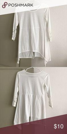 White Top White, semi sheer. 3/4 Sleeve. Bottom of sleeves are white lace. Back bottom half had open slit. Tops