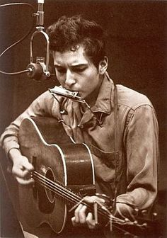 Bob Dylan at work making music and poetry in 1962.